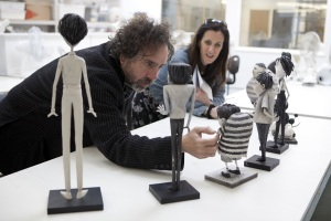 """""""FRANKENWEENIE""""  Director Tim Burton reviews the character maquettes in the Puppet Hospital with Producer Allison Abbate. ©2012 Disney Enterprises, Inc. All Rights Reserved. Photo by: Leah Gallo"""